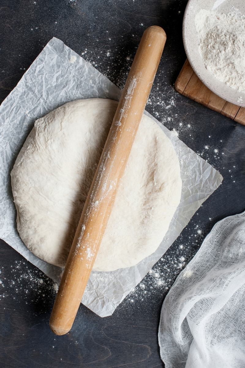 Image result for Use your fist to punch down the pizza dough. Knead until smooth.