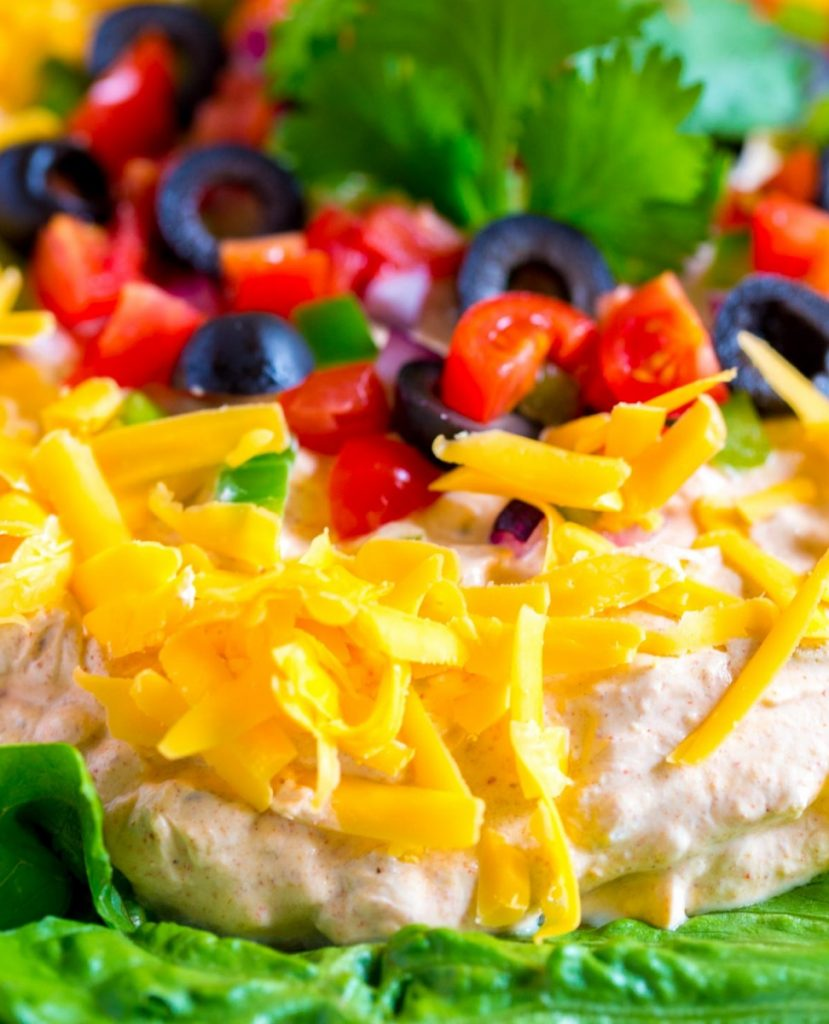 Fiesta Taco Dip. A quick an easy Mexican appetizer. Perfect recipe for game day as well as parties, gatherings and Cinco de Mayo celebrations.