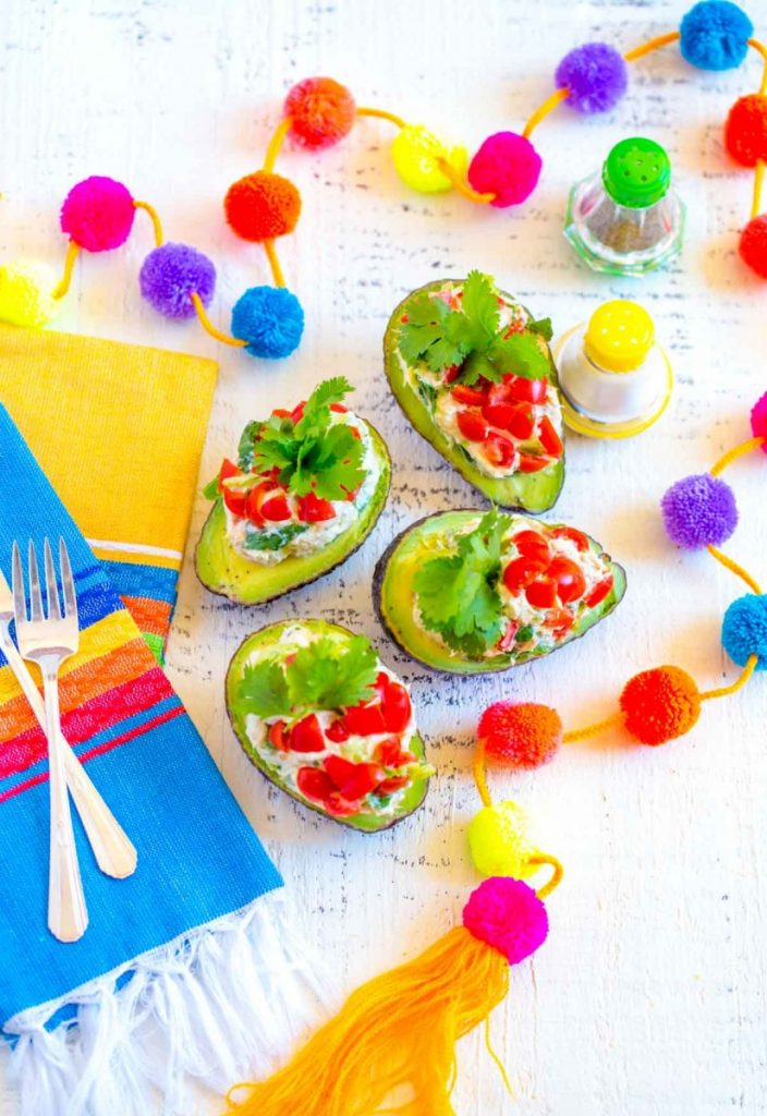 Stuffed Avocado. A delicious recipe made with tuna salad and a Mexican twist!
