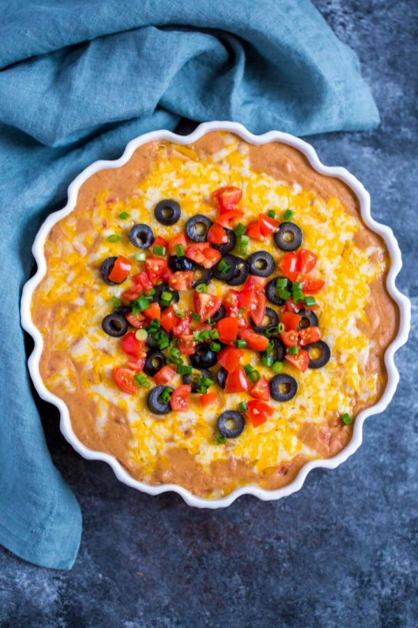 Mexican Bean Dip served in a beautiful fluted dish.