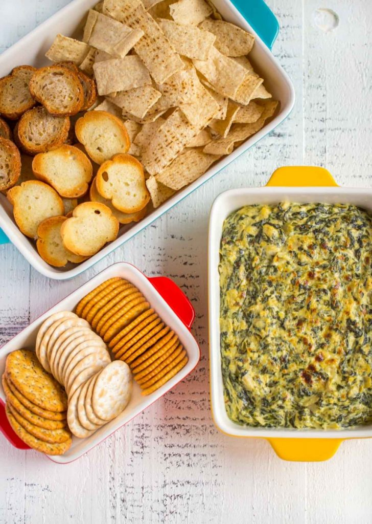 Spinach Artichoke Dip served in an appetizer baking dish.