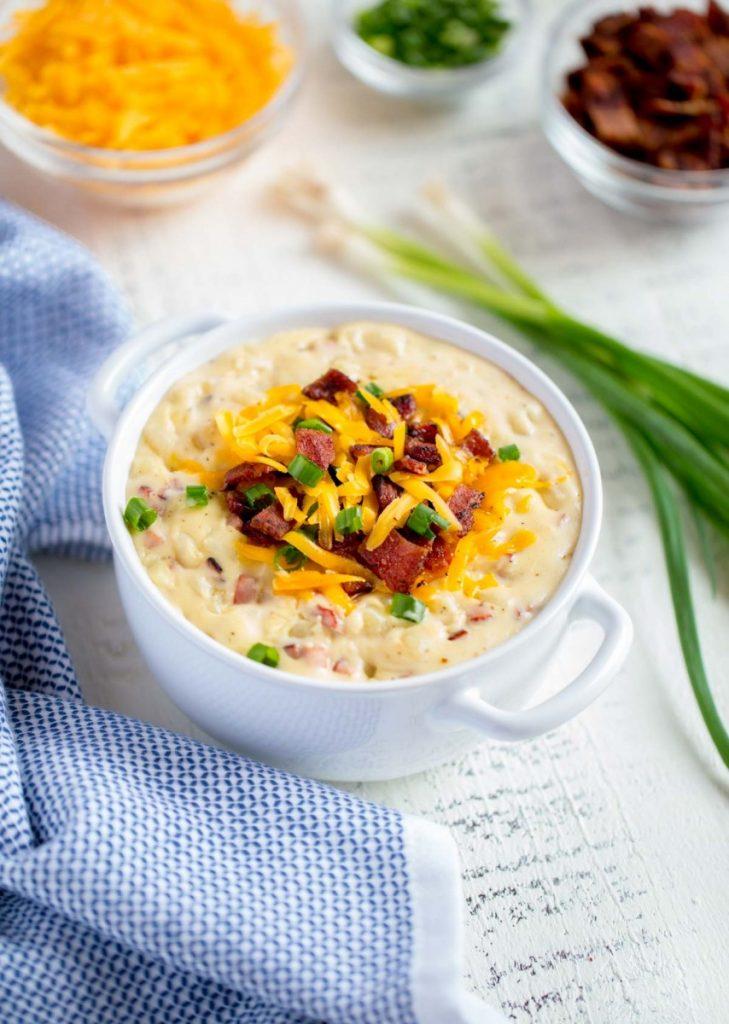 Baked Potato Soup served in a white soup bowl.
