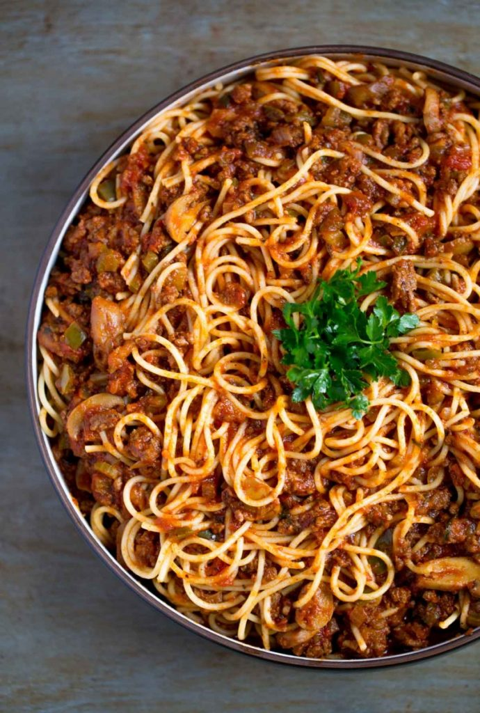 Spaghetti meat sauce with pasta in a serving bowl