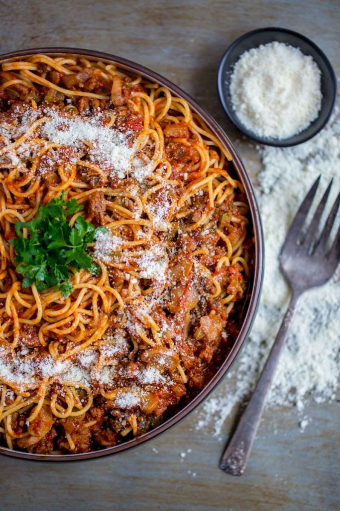 Spaghetti meat sauce garnished with Parmesan cheese