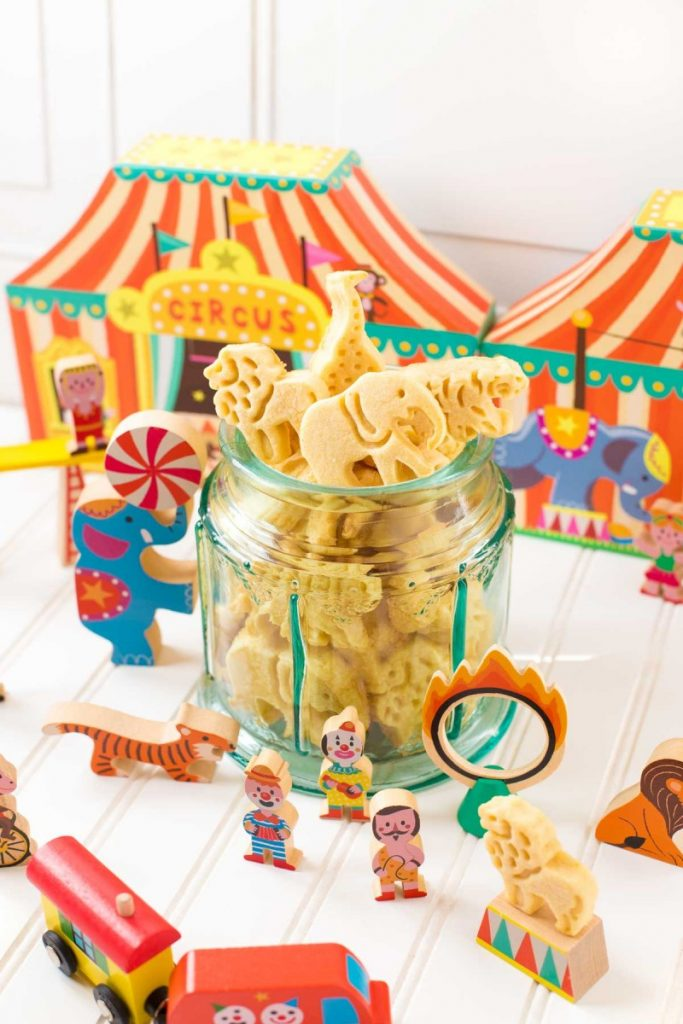 Animal Crackers served in a clear carousel cookie jar.