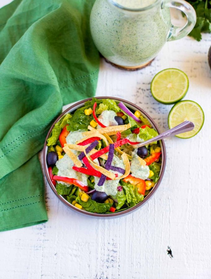 Creamy Cilantro Lime Dressing sprinkled with colorful tortilla strips.