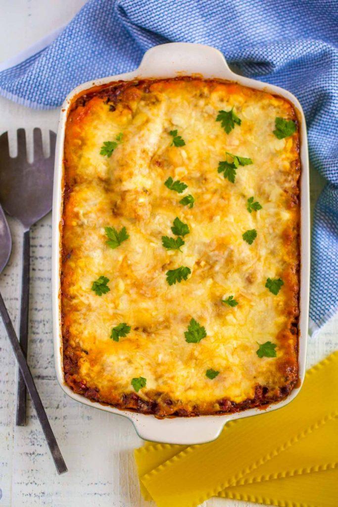 Homemade lasagna in a casserole dish.