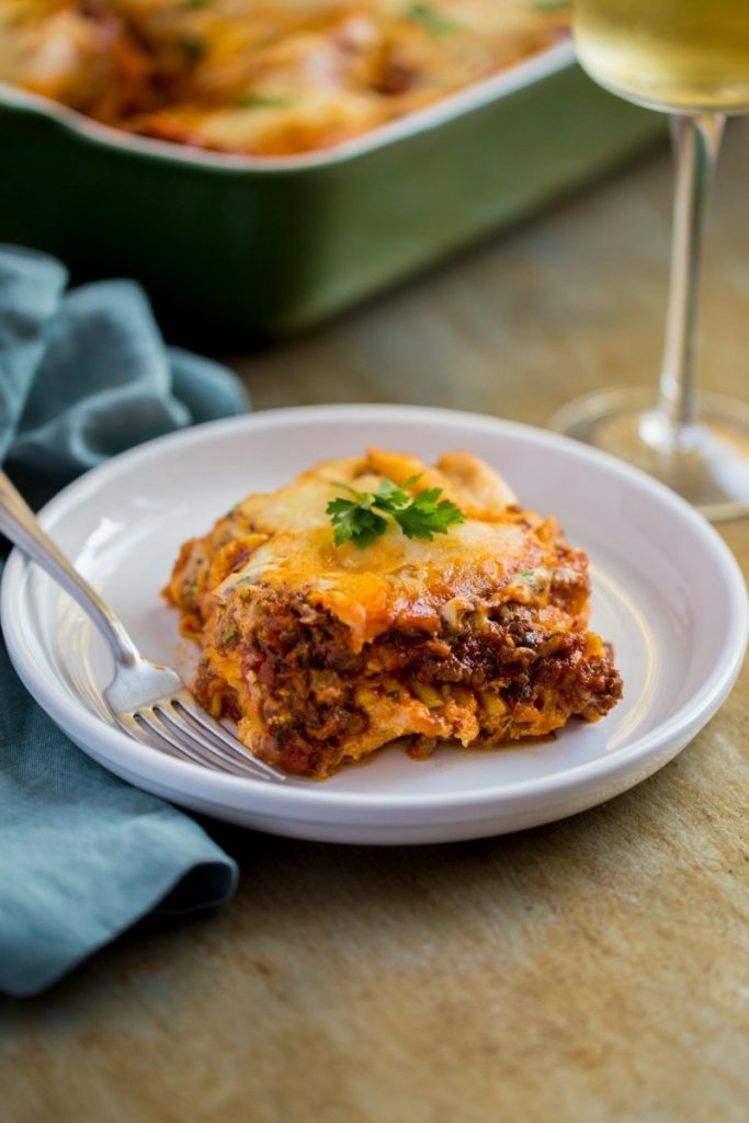 Easy lasagna recipe shown on a plate with fork.