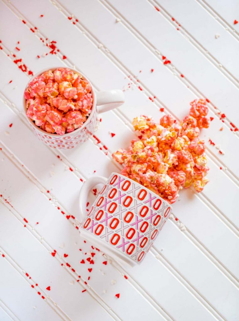 Old fashioned pink candied popcorn in a bowl.