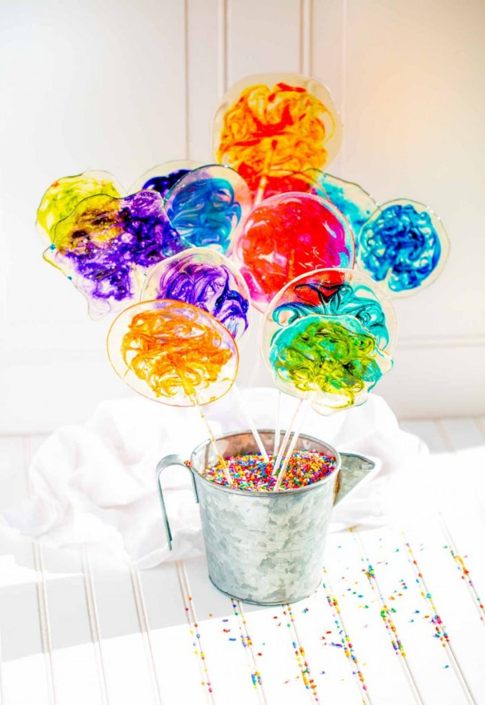 DIY stained glass lollipops with bright colorful swirls.