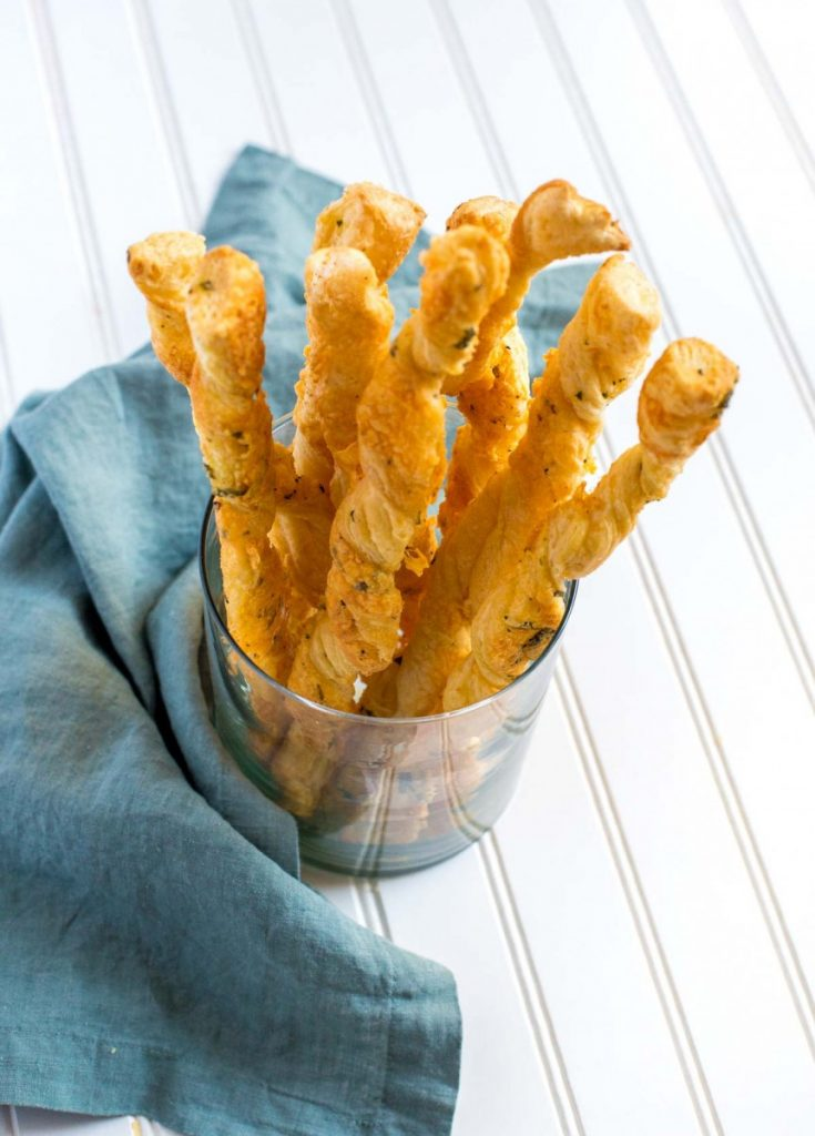 Puff Pastry Cheese Straws in a glass jar.