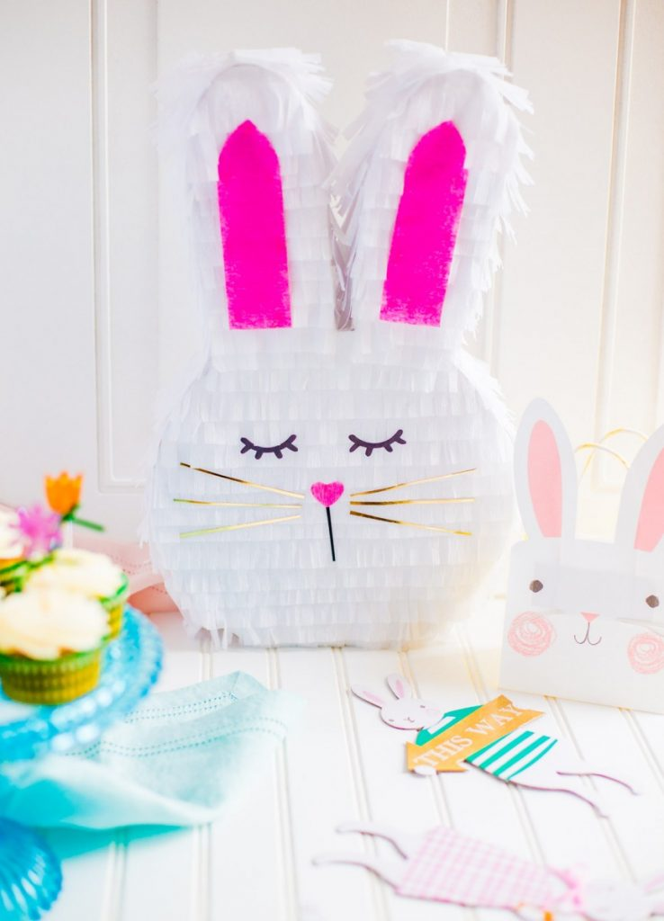 DIY Bunny Pinata for Easter tablescape with carrot cake cupcakes.