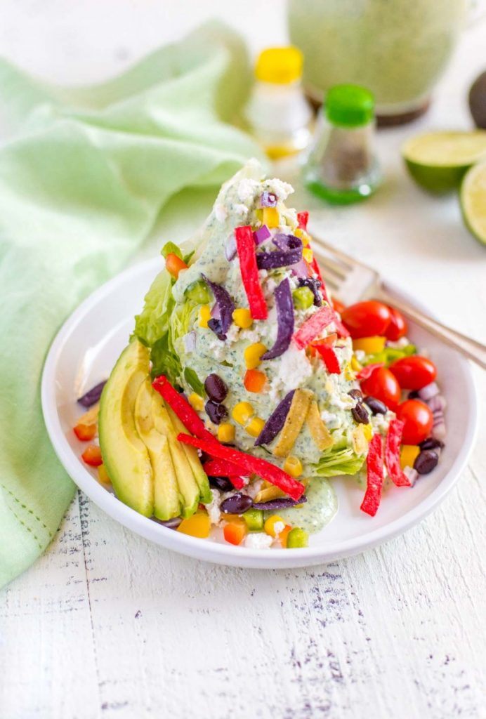 Colorful Mexican Wedge Salad with flavorful garnishes.