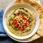 Roasted Garlic Hummus served with pita bread.