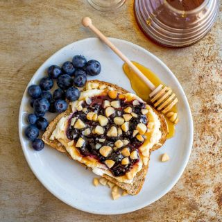 Breakfast Sandwich with ricotta, blueberry preserves, honey and Macadamia nuts.