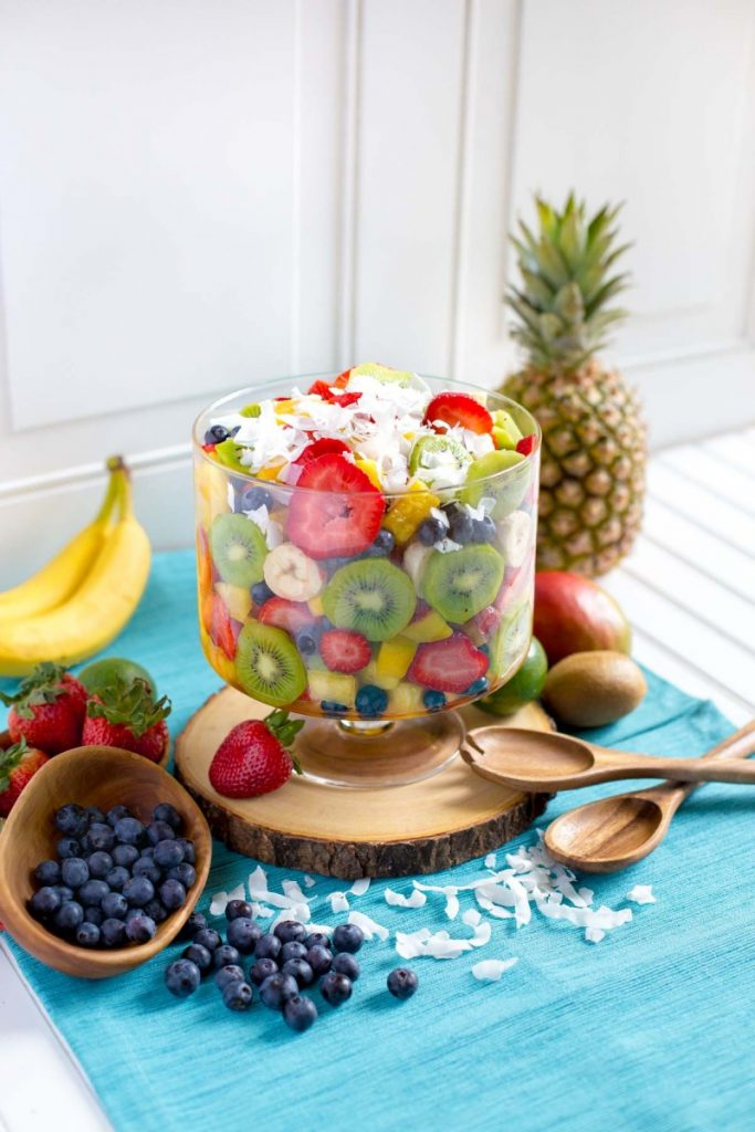 Tropical Fruit Salad served in a glass trifle bowl.