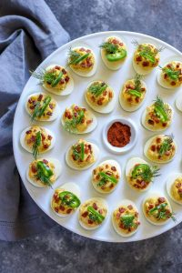 Deviled eggs on a white egg tray