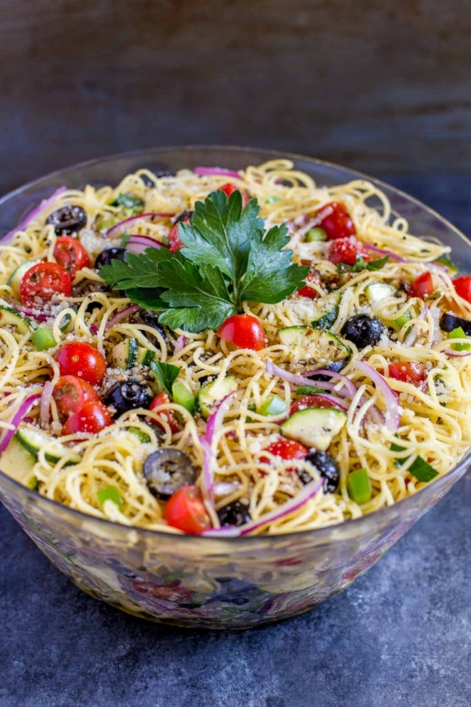 Cold spaghetti salad in a serving bowl.