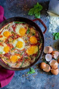 Eggs In Purgatory cooked in a cast iron pan