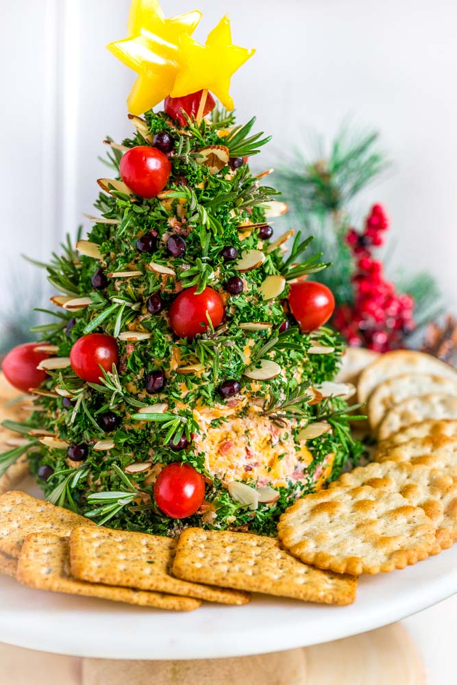 Crackers around a Christmas tree cheese ball