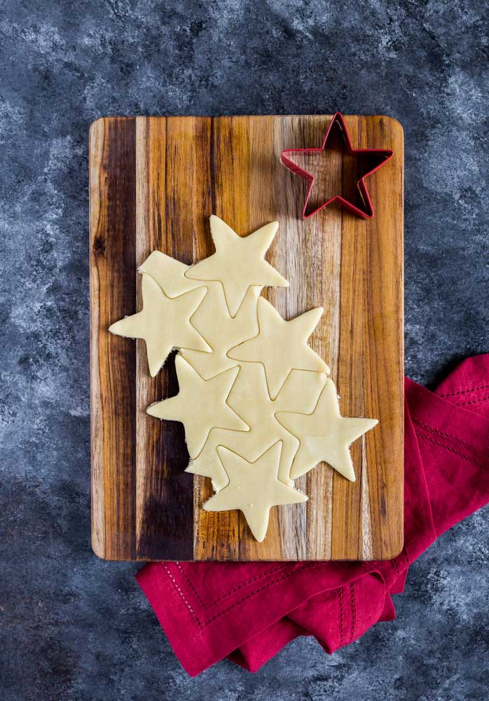 Sugar Cookies on a cutting board.