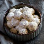 Snowball Cookies in galvanized metal bowl.