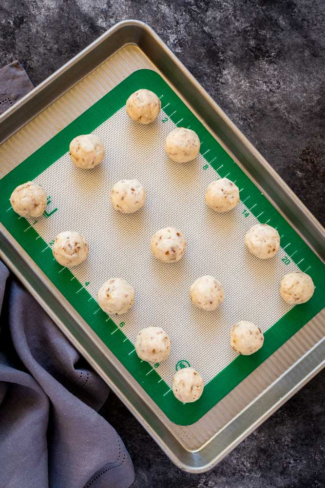 Snowball cookies on a cookie sheet