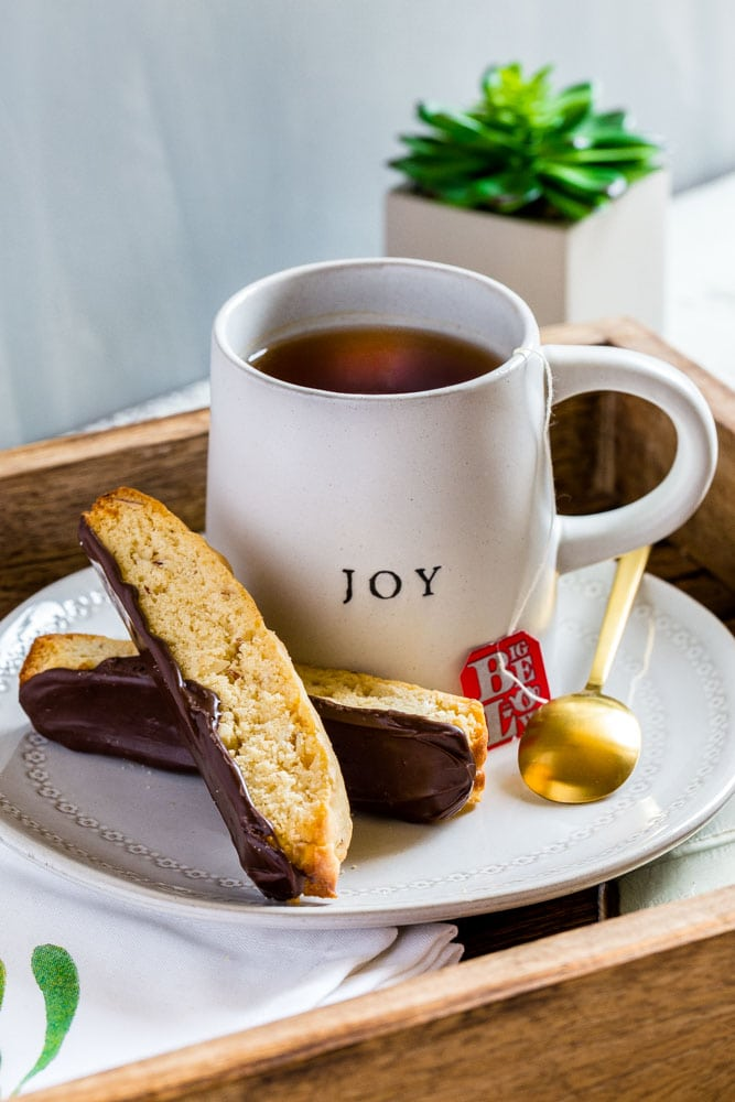 Two pieces of Italian Biscotti with bottoms coated in chocolate enjoyed with a hot beverage.