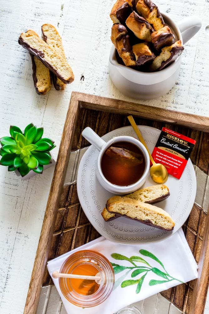 Biscotti served on a tray with tea.