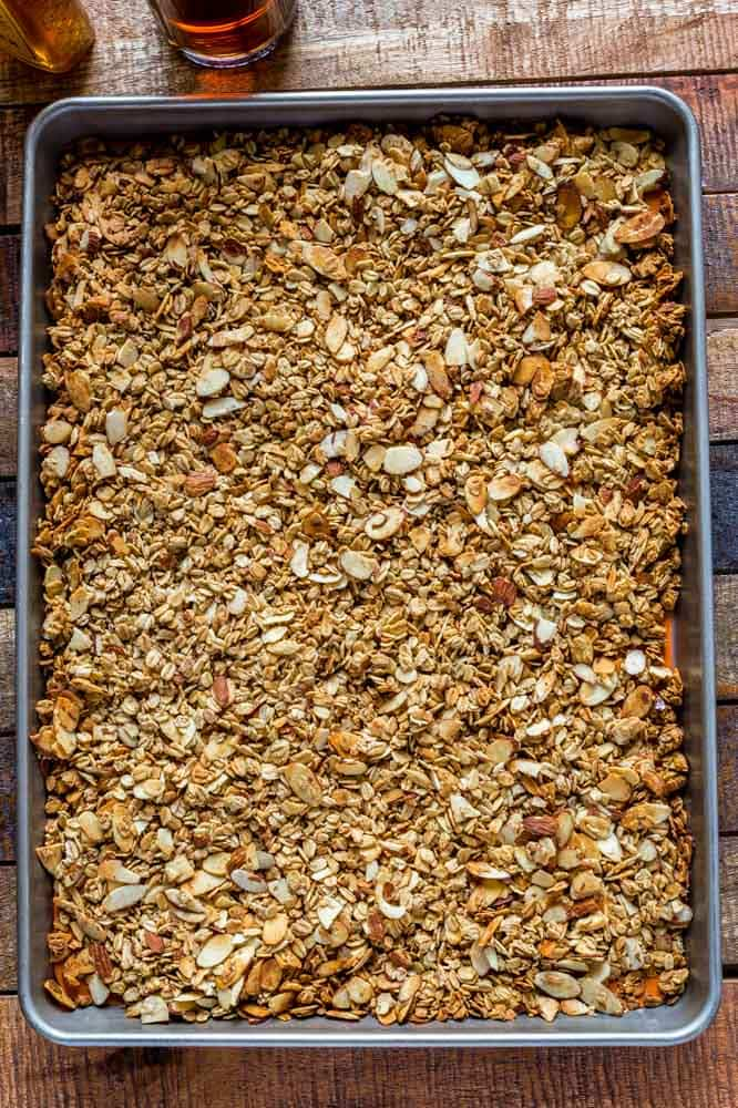 Granola cooking on a baking tray.