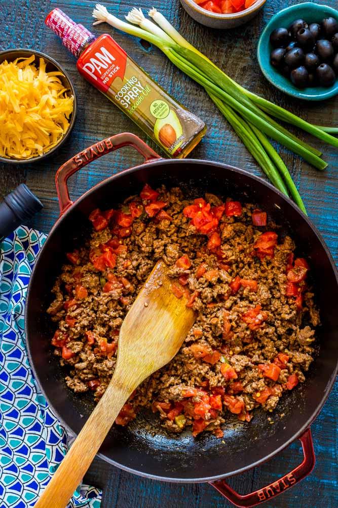 Preparing meat for mini tacos.