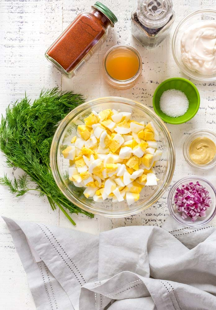 An overhead view of egg salad recipe ingredients.