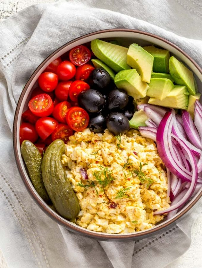 Egg Salad in a bowl with veggies.