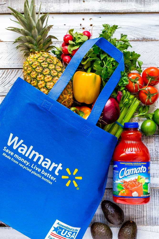 Blue Walmart bag filled with ingredients for grilled shrimp skewers.
