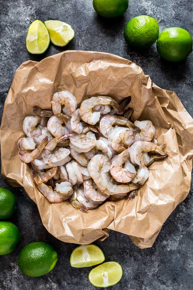 Raw shrimp in butcher paper for grilled shrimp skewers.