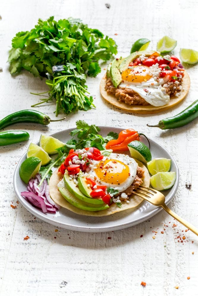 Huevos Rancheros on a plate with lime slices.