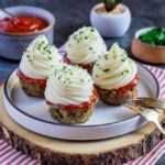 Meatloaf Cupcakes with whipped mashed potatoes on top.