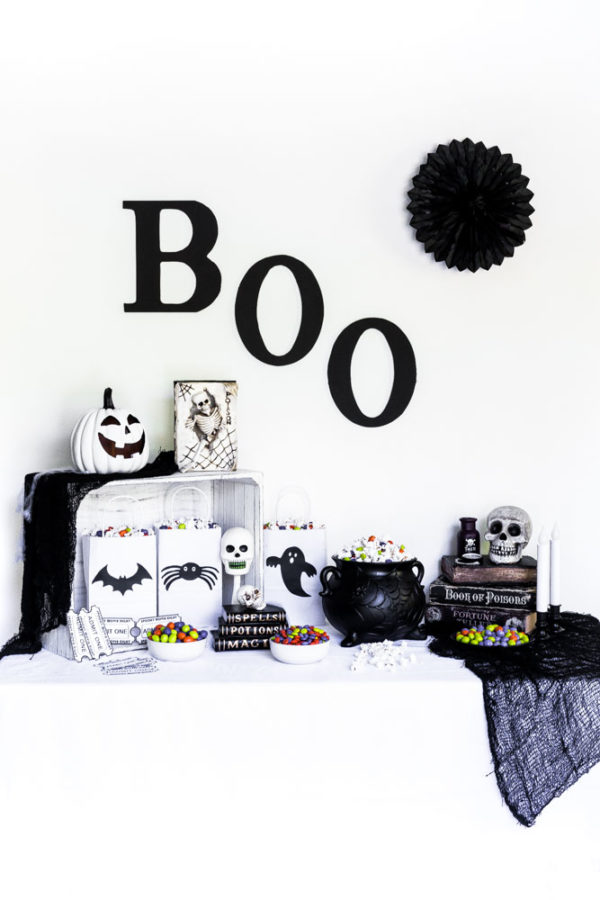 DIY Halloween Popcorn Bags as part of a Halloween party tablescape.