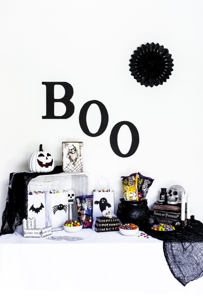 Halloween Movie Night party table with spooky decorations.