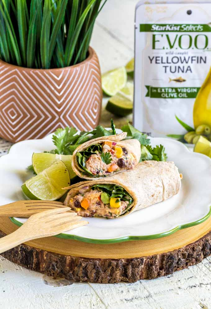Healthy wraps with chipotle mayo served on a white plate with a cilantro garnish.