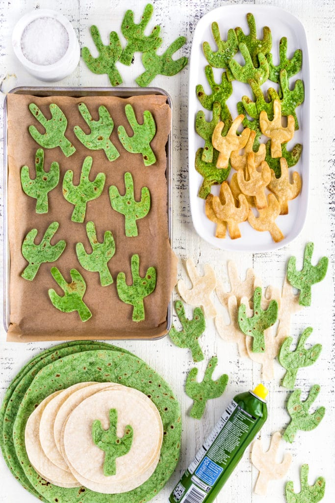 Baked cactus shaped tortilla chips made from green flour tortillas and yellow corn tortillas.