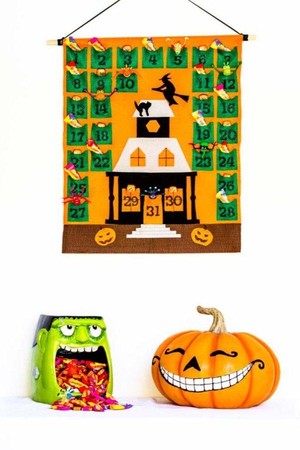 Halloween Countdown Calendar hung on a white wall.