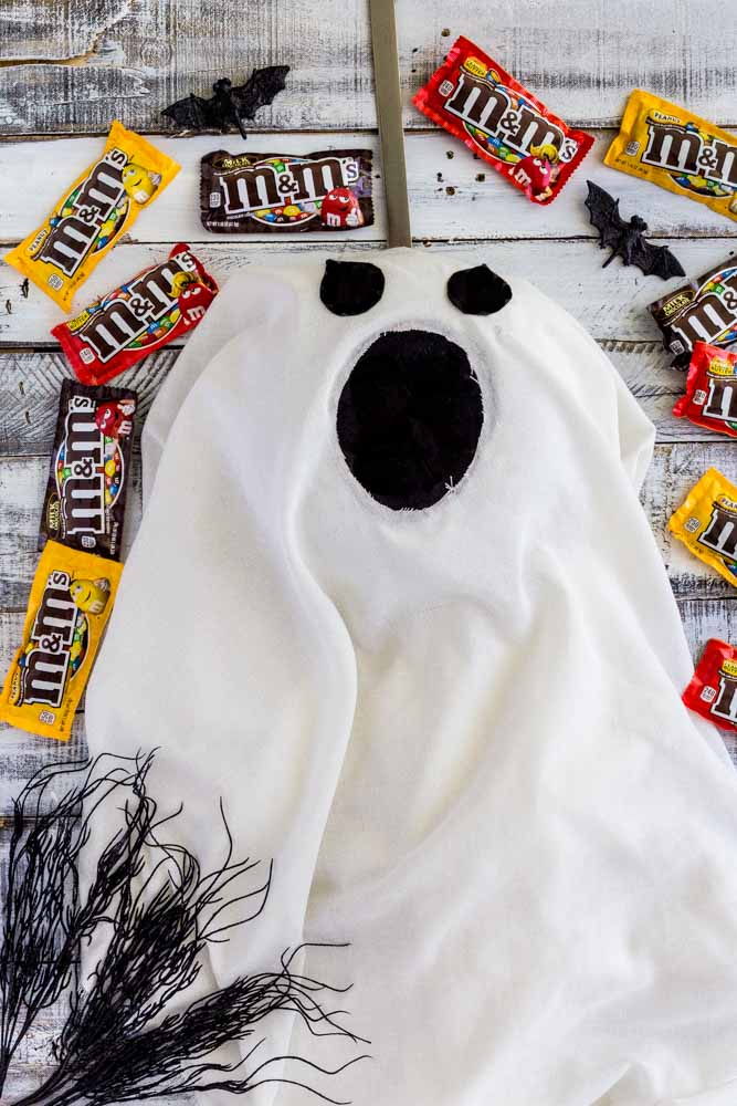 Ghost Door Hanger surrounded by packets of candy.