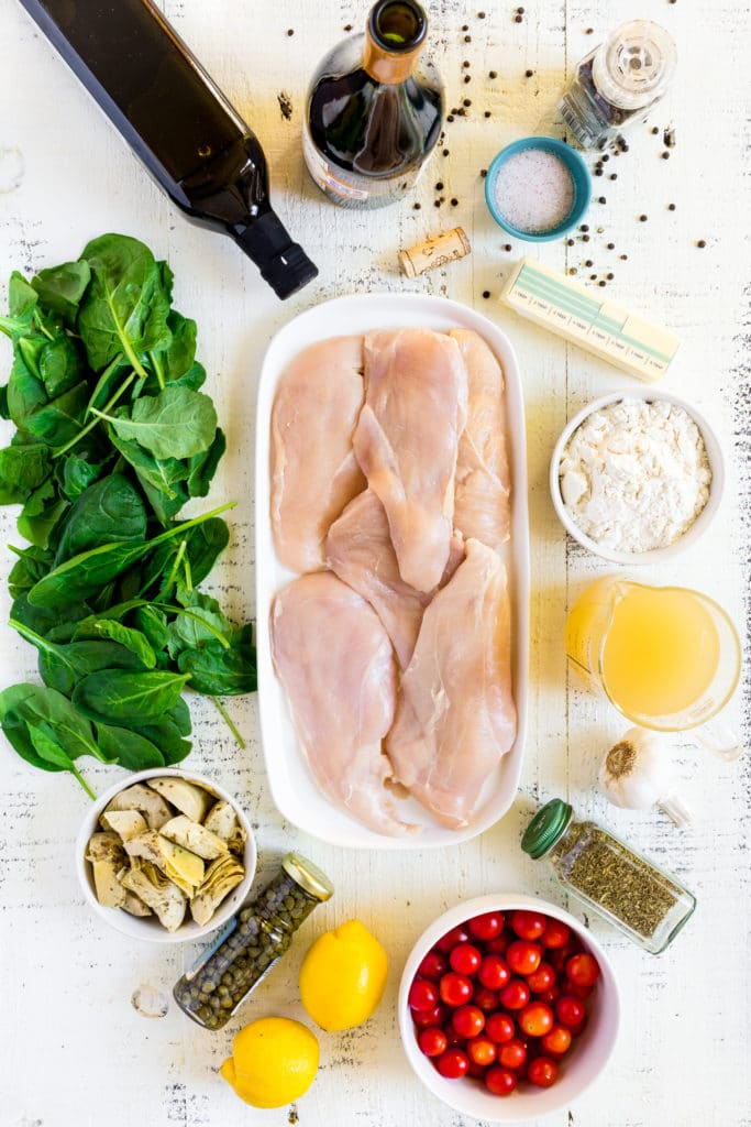 Ingredients for making healthy chicken piccata from scratch.