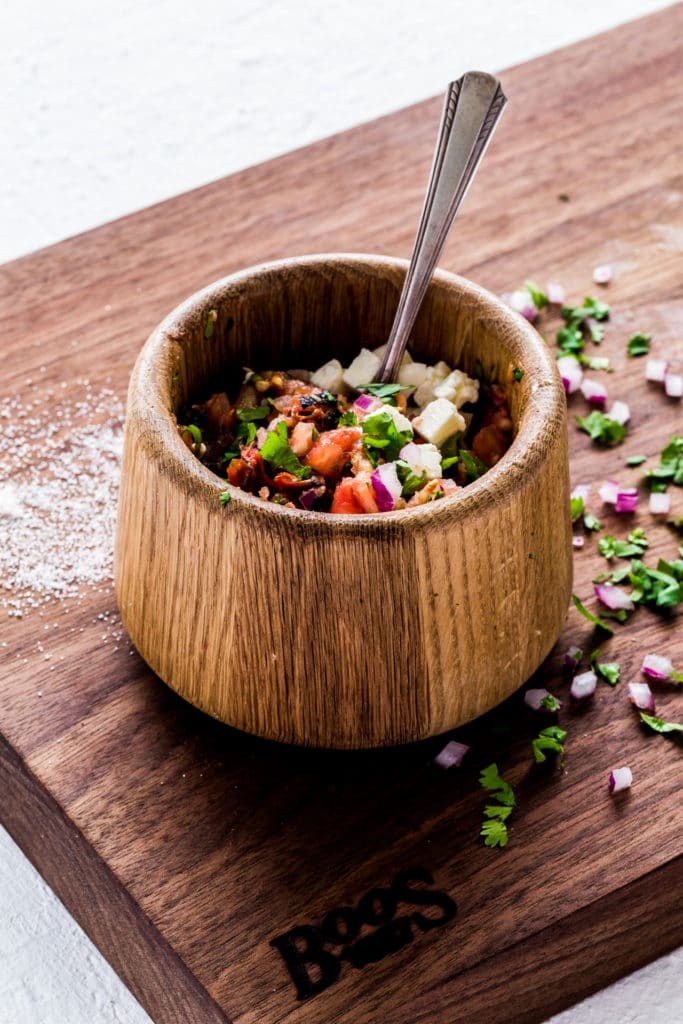 Authentic Mexican salsa served in a rustic wooden bowl.