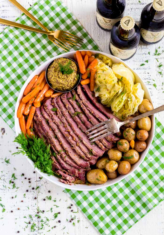 A corned beef dinner served on a platter for St. Patrick's Day.