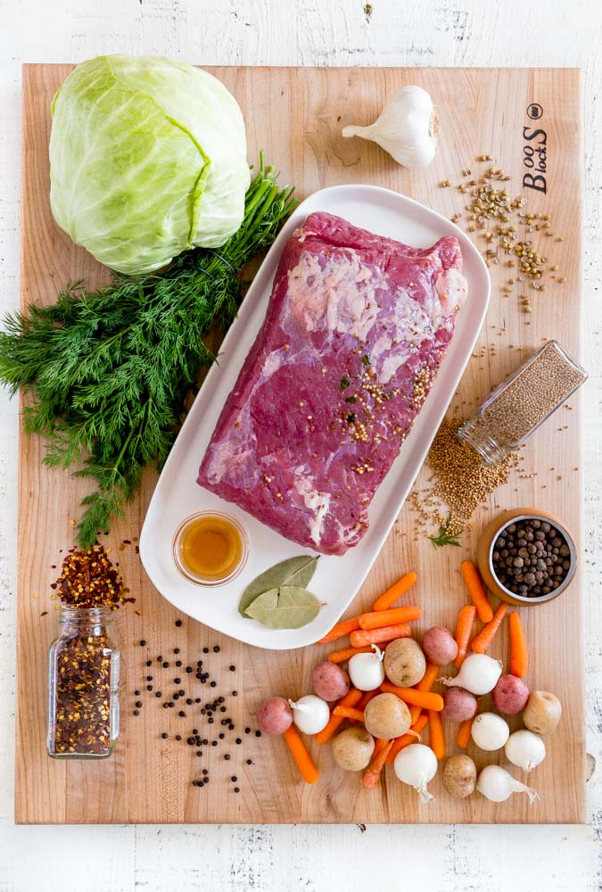 Ingredients for making corned beef and cabbage laid out on a Boos Board.