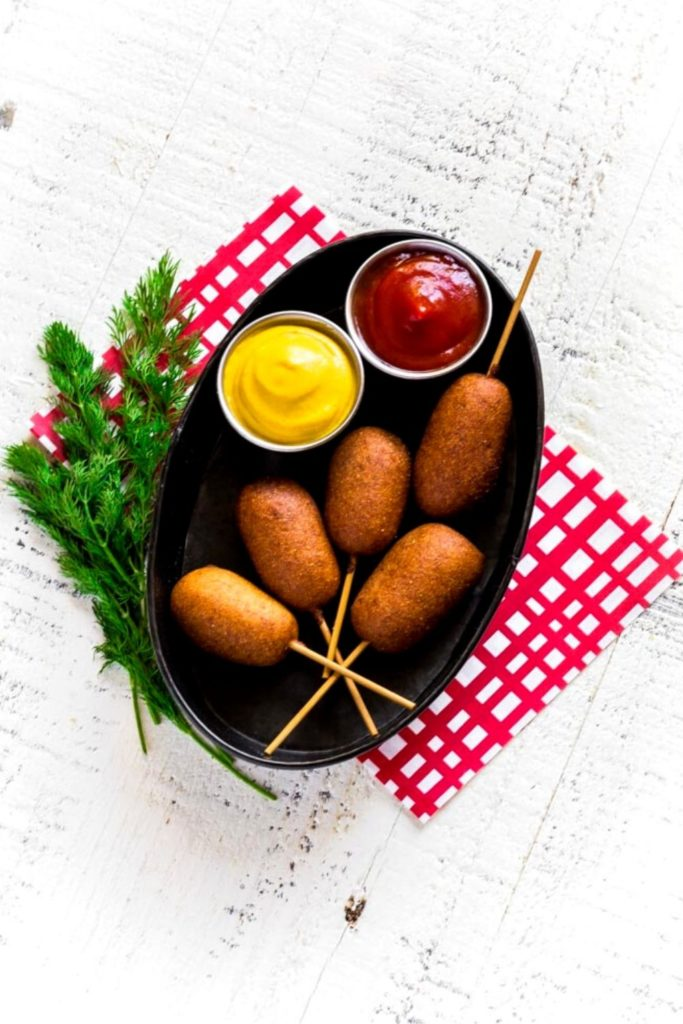 Homemade Corn Dogs served in a metal food basket.