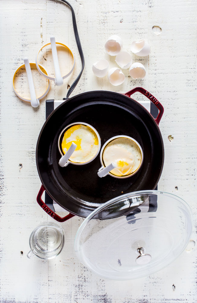 Making fried eggs using Williams Sonoma egg fry rings in a Staub universal pan with lid.