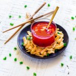 Chinese Sweet and Sour Sauce served with wonton strips.